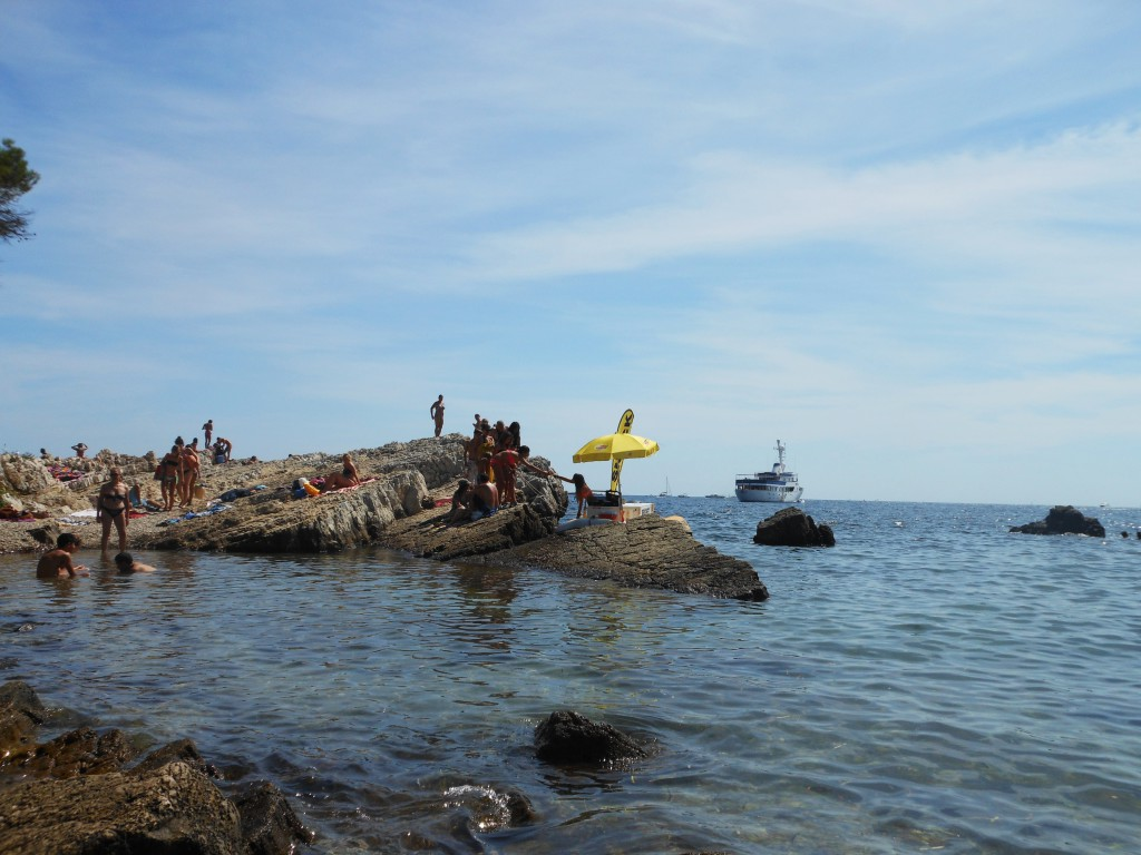 Tourists on Ile de Lerins enjoying the sun